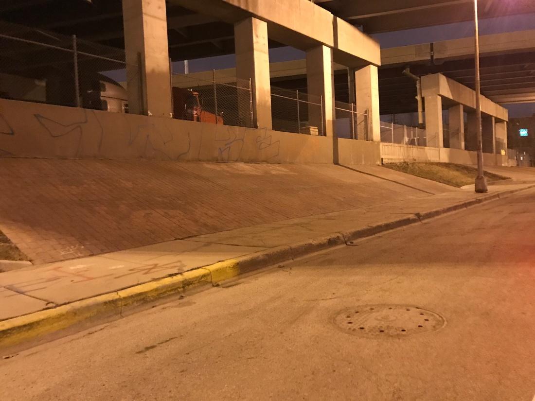 Wide angle photo of brick banks under a Chicago expressway bridge