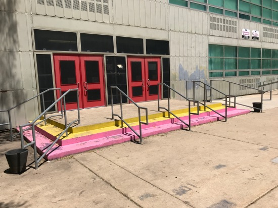 Photo of colorful stairs in the courtyard of Darwin Elementary
