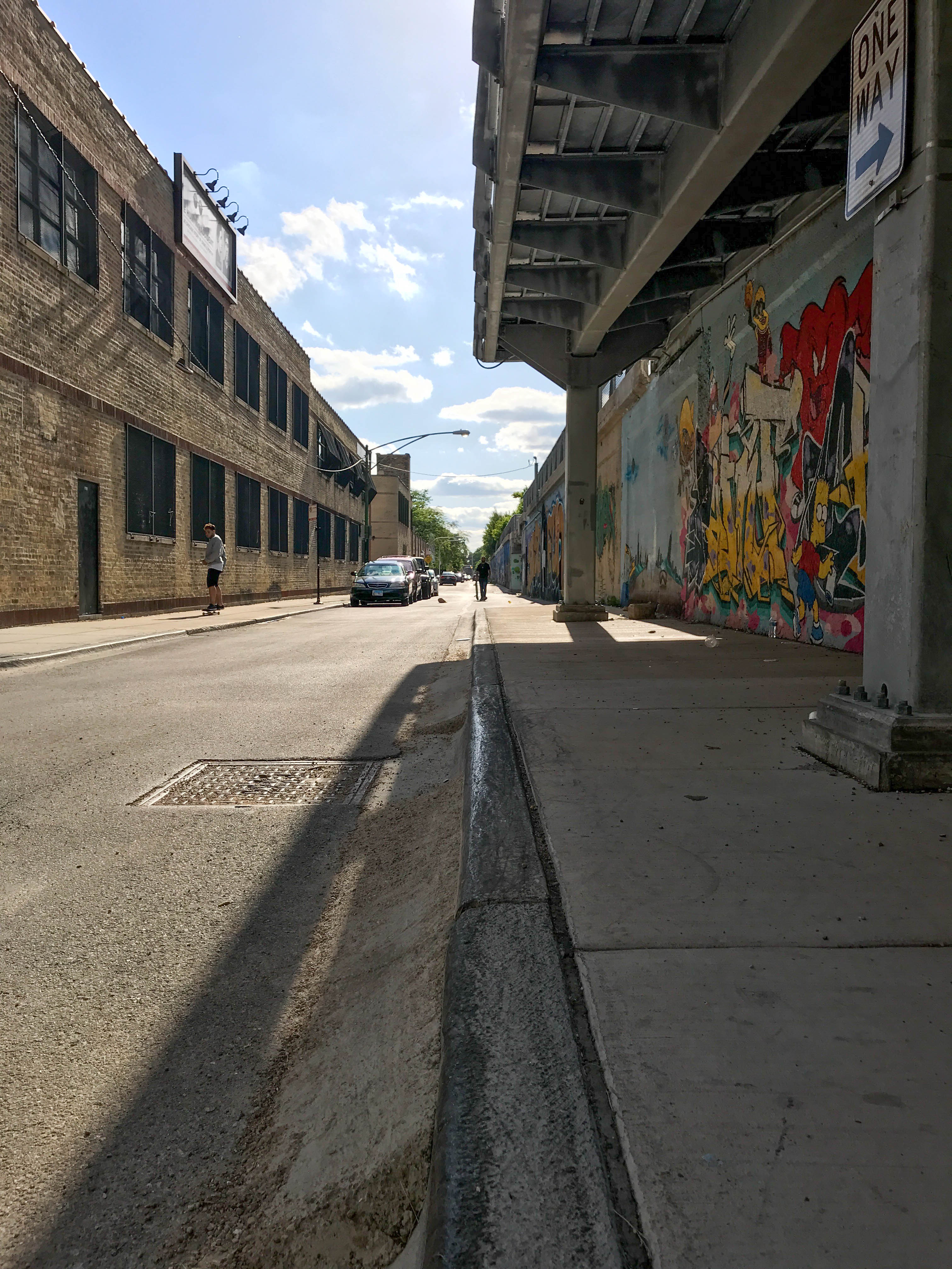 Photo of a curb with a cemented ramp on Bloomingdale street by the 606 trail